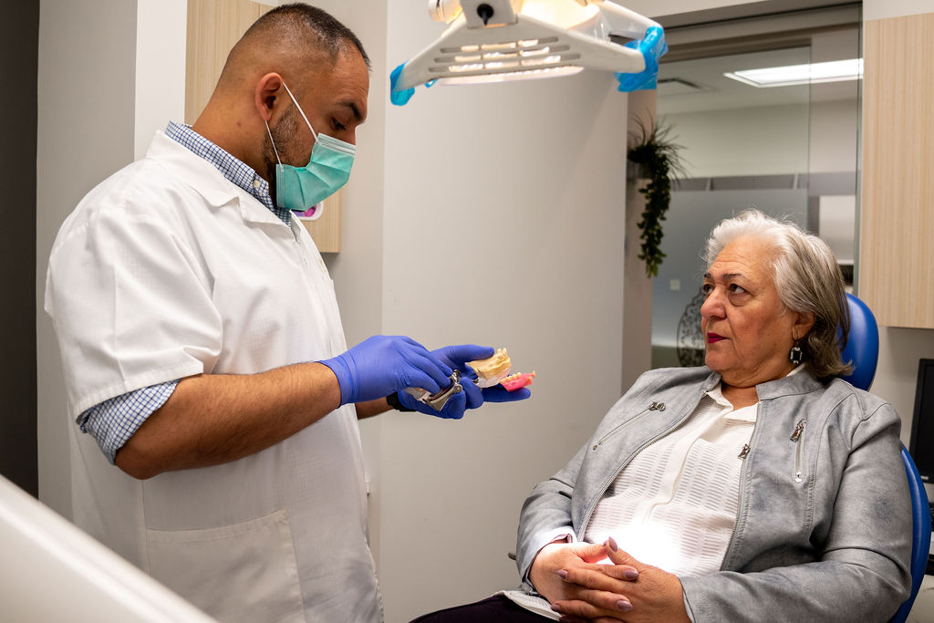 A woman has an appointment at BLOK Dental Family Friendly Clinic in Saskatoon Saskatchewan in regards to dentures.